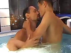 Two young gracious dudes frisking in swimming pool