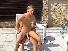 Two young blond boys lick asses and fuck by pool