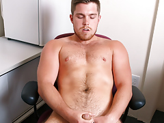 Marko Lebeau jerks his uncircumcised cock while sitting at his desk