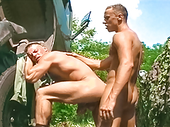 2 sweaty soldiers get tired of working & blow off some steam