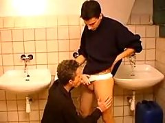 Two naughty twinks swallowing rods in public lavatory