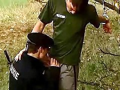 Policeman taking in convict in nature