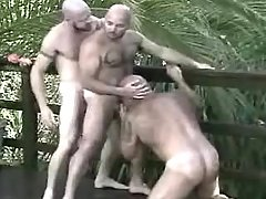 Lusty mature gays suck and play with tongue in group