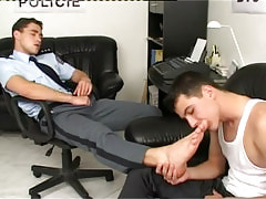 Cute twink licks legs of policeman