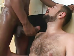 Hairy man attains dick water by ebony dude