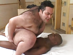 Horny bear twink rides huge black pecker