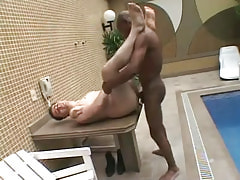Poor guy drilled by ebony gay on table