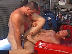 Muscle men very in the garage