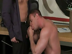 Muscle homosexual sucks hard cock in office