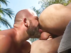 Bear male licks out shaggy apple bottoms outdoor