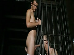 Bad twink in cage sucks raw cock