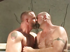 Mature bear man-lovers kiss outdoor