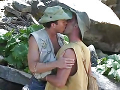 Gay fisherman kisses ally by river