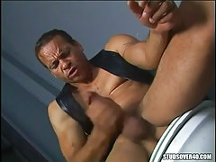 Latin dilf plays with cock