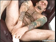 Hairy twink deep pushes large toy in anus