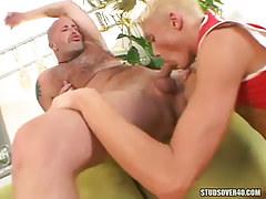 Hot golden-haired mate throats appetizing cock of bear