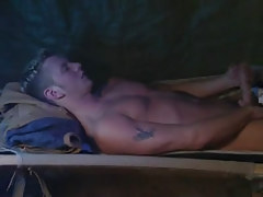 Cute gay masturbates in bed