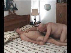 Old homosexual engulfing cock in daybed