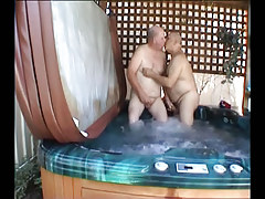 Fat calm gay guys giving a kiss in pool