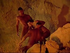 Three muscle gays swallow each other in cave