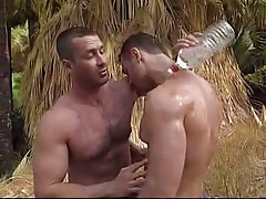 Muscle gay dilfs caress every other in jungle