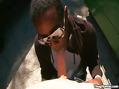 Ebony male in glasses throats white phallus outdoor