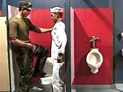 Navy boy sucks in water closet