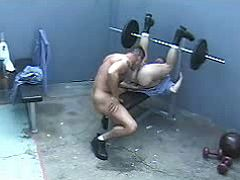 Rough beefy guys do keen oral-service job in prison gym