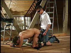 Kinky males participate BDSM at the attic with a slave-guy ass and mouth dug